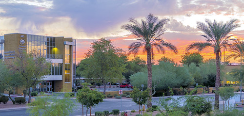 sunset clouds building reflections palms chandler arizona az