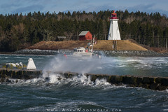 Coast Guard Boat and Breakwater Waves