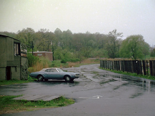 Taking a walk down Merwin Avenue on a rainy spring day, this slightly battered Buick with a white convertible vinyl roof parked near a tar paper shack caught my eye. Trees were greening up and that looked sweet after a long winter. Milford CT. May 12 1974