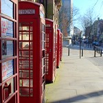 Row of red telephone boxes in Preston