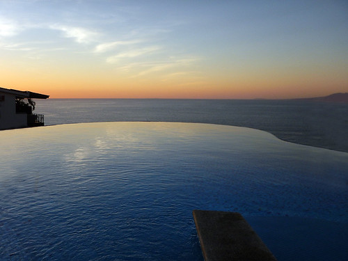 Sunset reflected in the infinity pool at the Sky Bar in Puerto Vallarta, Mexico