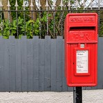 Small red post box