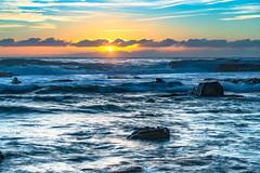 Sunrise seascape in the rocky alcove