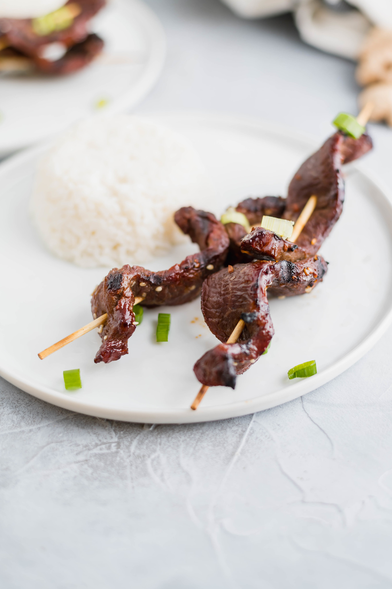Thinly sliced flank steak in a delicious Asian marinade and threaded onto skewers make up these delicious Grilled Steak Kabobs. Sure to be a summertime favorite.
