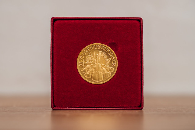 Close-up of a gold coin in a red velvet box