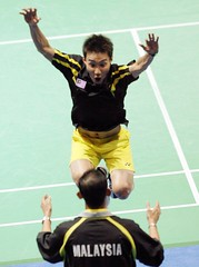 Victory leap! Quick reflexes captured the moment Datuk Lee Chong Wei unexpectedly leaps into the arms of his coach Misbun Sidek after delivering the winning shot against South Korea's Lee Hyun-il 21-18, 13-21 and 21-13 at the Beijing Olympics.