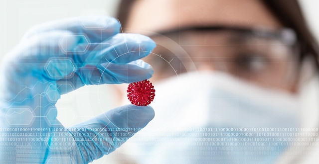 A woman scientist holding a coronavirus in a research lab