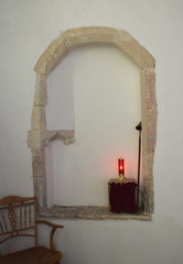 sanctuary light in remains of piscina and sedile