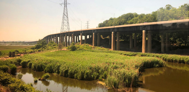 The lovely New Jersey Turnpike slicing though everything in its path. It was built to go through Snake Hill in the Meadowlands in the 1950s. The hill once housed a 19th century insane asylum, a hospital for typhoid patients and a potters field.  Aug 2010