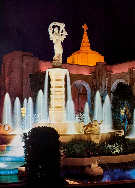"""""""Court of Flowers with Sculptor O.C. Malmquist's 'Girl and Rainbow"""" fountain.  Tower of the East in the background."""""""