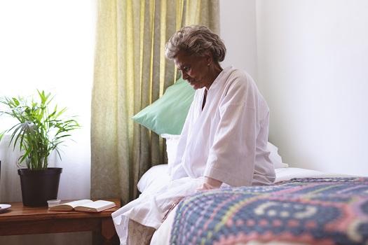 Senior woman sitting upset in nursing home