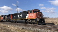3/5/21 11:44 33 degrees at CN Potterville as CN 5722 leads a 2 unit Train 356 past the grain elevators with racks for Corey Yard Lansing. Thanks for the horn taps!! ud83dude01Full 5:19 video: