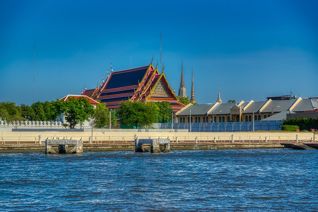 Wat Pho, home of the reclining Buddha, seen from the Chao Phraya river in Bangkok, Thailand