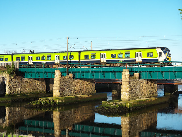 29000 Class DMU passes over the Dargle on a newly painted bridge