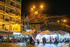 Gate of Ninh Kieu Street Night Market with many Clothing Shops and Food Stalls in the City Center of Can Tho, Vietnam