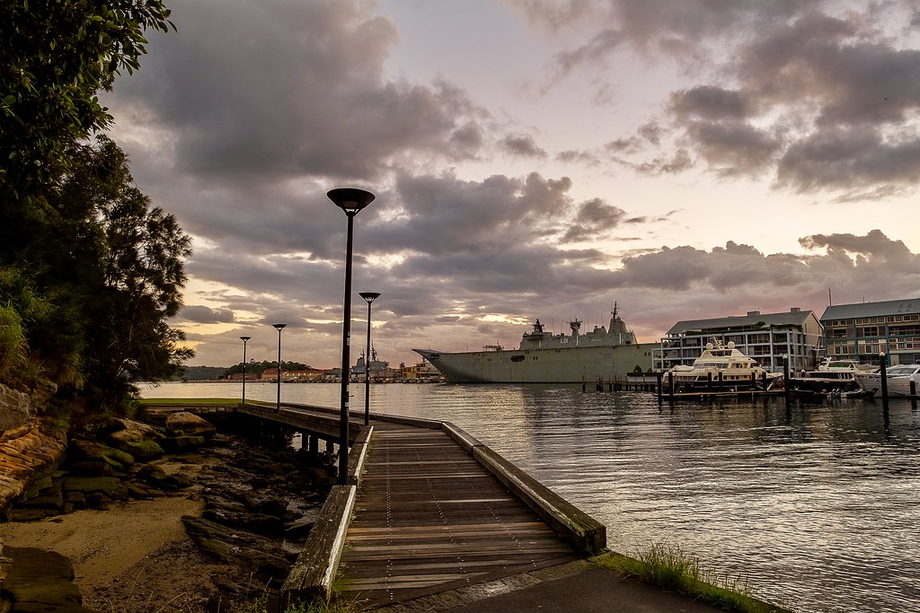 For both Sydneysiders and visitors alike, a must do is a dawn walk from the heel of Woolloomooloo Bay around the eastern side and up the stairs towards Mrs  Macquarie's chair.  A very peaceful stroll right next to the busy city.