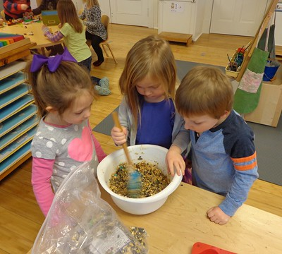stirring up the bird feeder mix