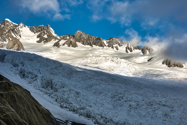 Light and shade at the top of the ice glacier in the Southern Alps