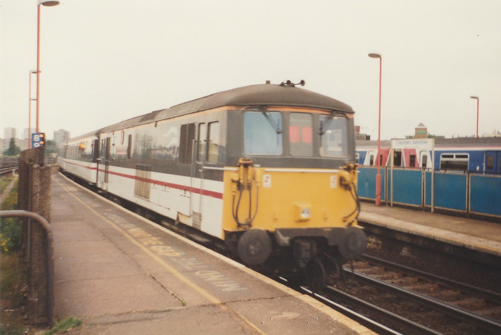 73 207 'County of East Sussex' passing through Clapham Junction