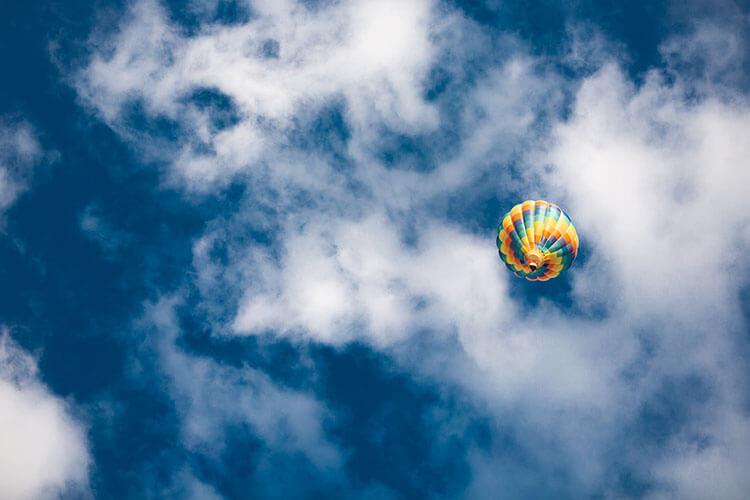 hot air balloon arrives at its peak rise