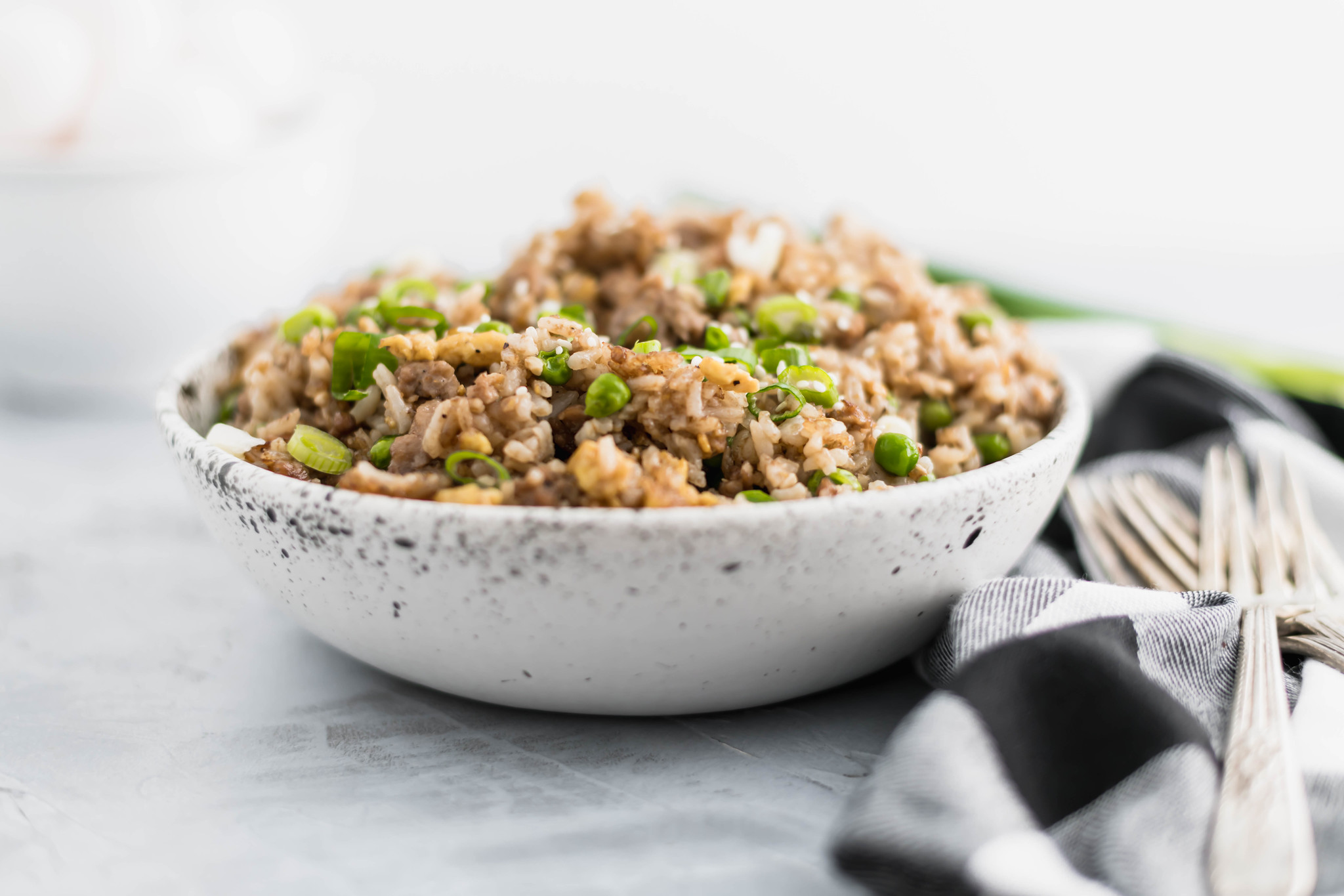 This Chinese takeout inspired Ground Pork Fried Rice is super fast to throw together for lunch or dinner. A great use of leftover rice.