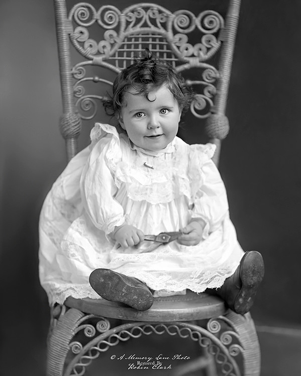 This child's portrait was taken by photographer John (Jno) Johnson of Centerville, South Dakota, circa 1889-early 1900s.