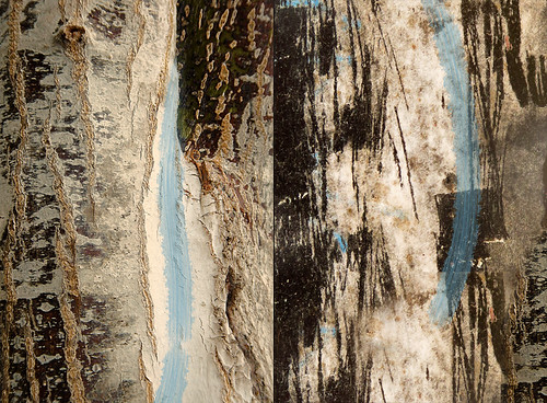 Abstract combo of tree bark and scratched paper on a black lamppost