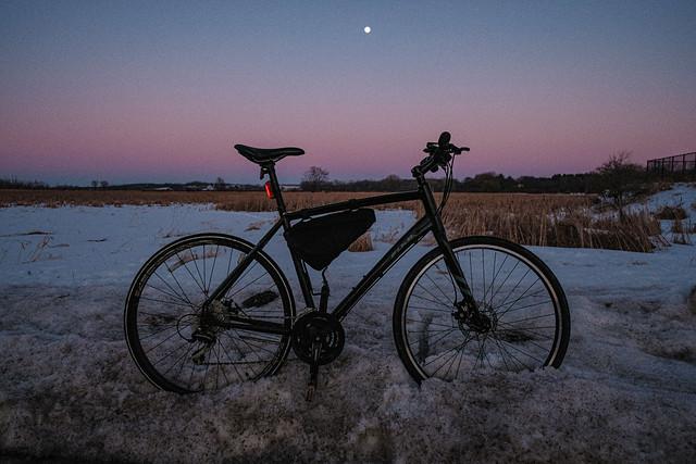 Moon above bike below.