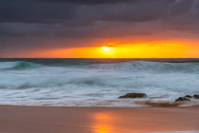 A moody overcast sunrise seascape