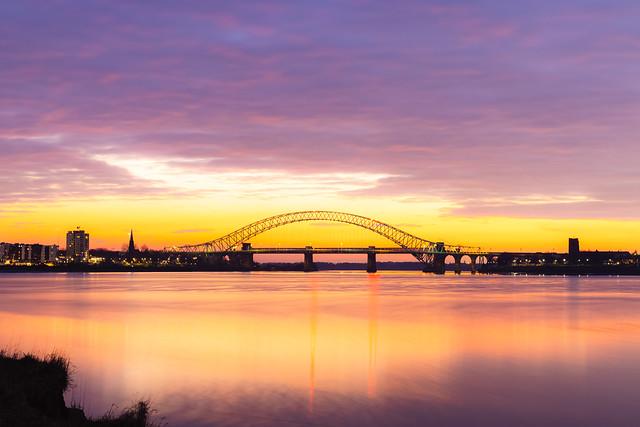 Silver Jubilee Bridge in Runcorn with the sun setting in the background