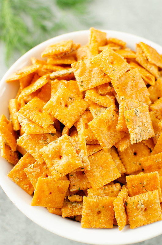Ranch Cheez-Its in white bowl with fresh dill in background