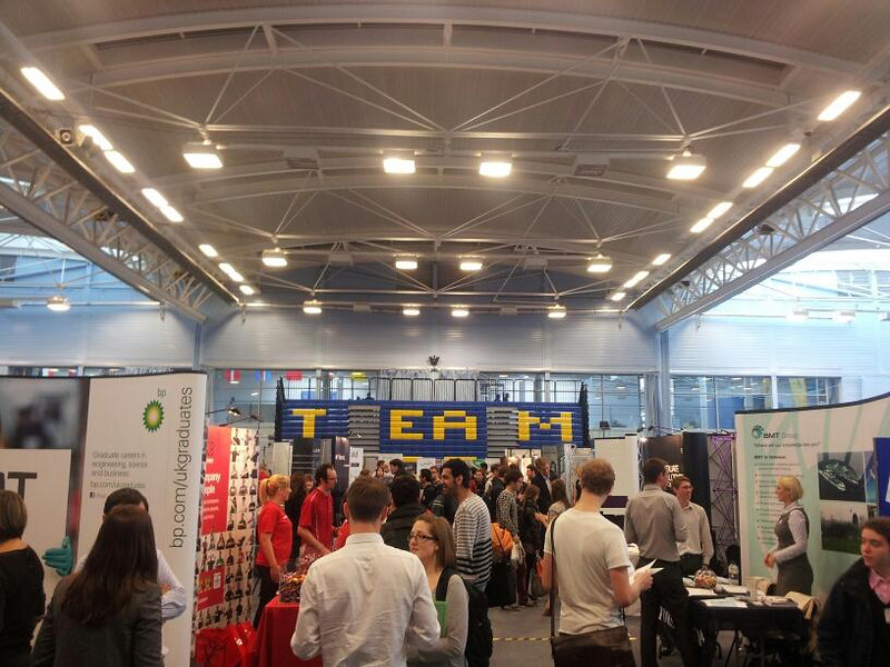 Students meeting employers at a previous in-person fair