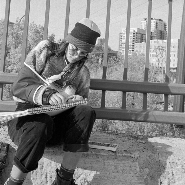 Young artist on the bridge