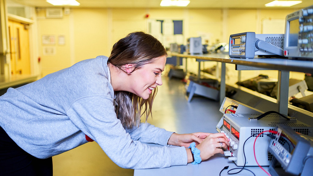 Physics students carrying out an experiment on a computer