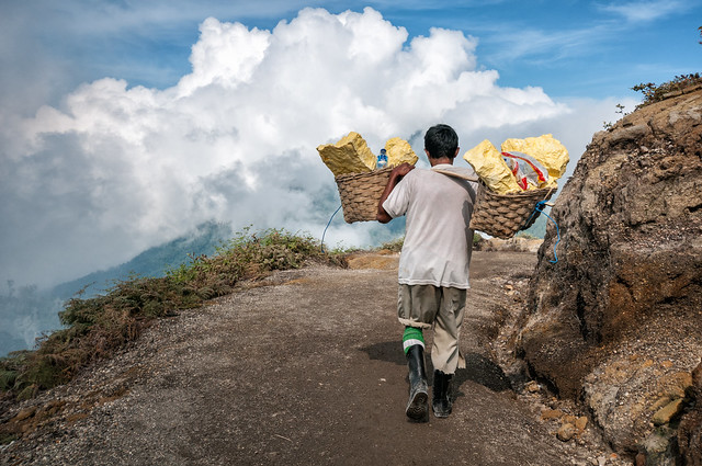 Porter carrying sulfur on a trail of Ijen volcano - Java Island - Indonesia