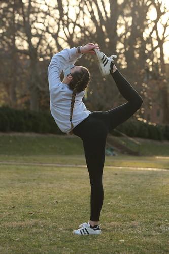 Practicing yoga in the Sunken Garden during Spring Break days.
