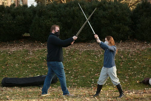 A couple of fencers spar in the Sunken Garden on the first Spring Break Day.