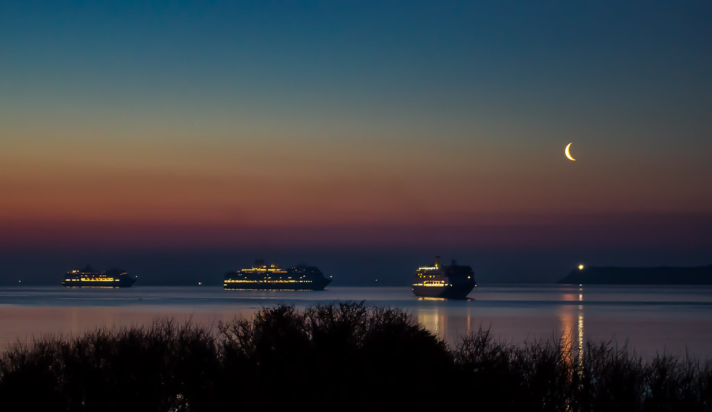 Cruise Ships, moon and lighthouse