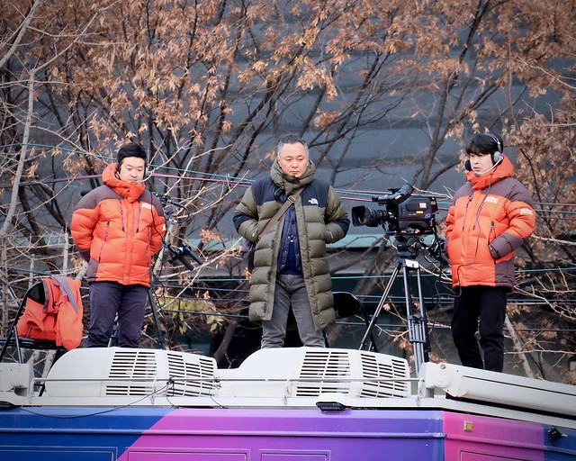 Media Men Monitoring a March