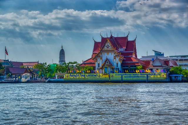Wat Rakhang Khositaram by the Chao Phraya river in Bangkok, Thailand