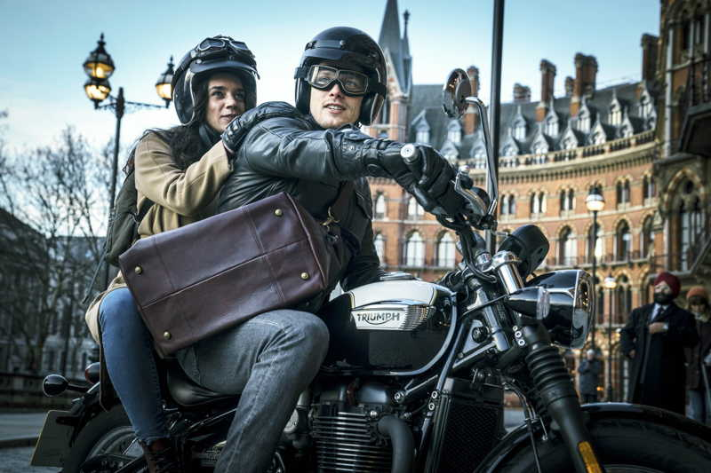 The actors driving a motorbike at London St Pancras