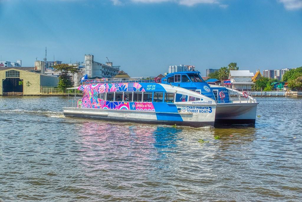 Tourist boat catamaran on the Chao Phraya river in Bangkok, Thailand