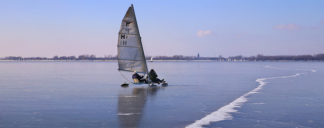 Tandem ice sailors crossing the flat ice of the Gouwsea