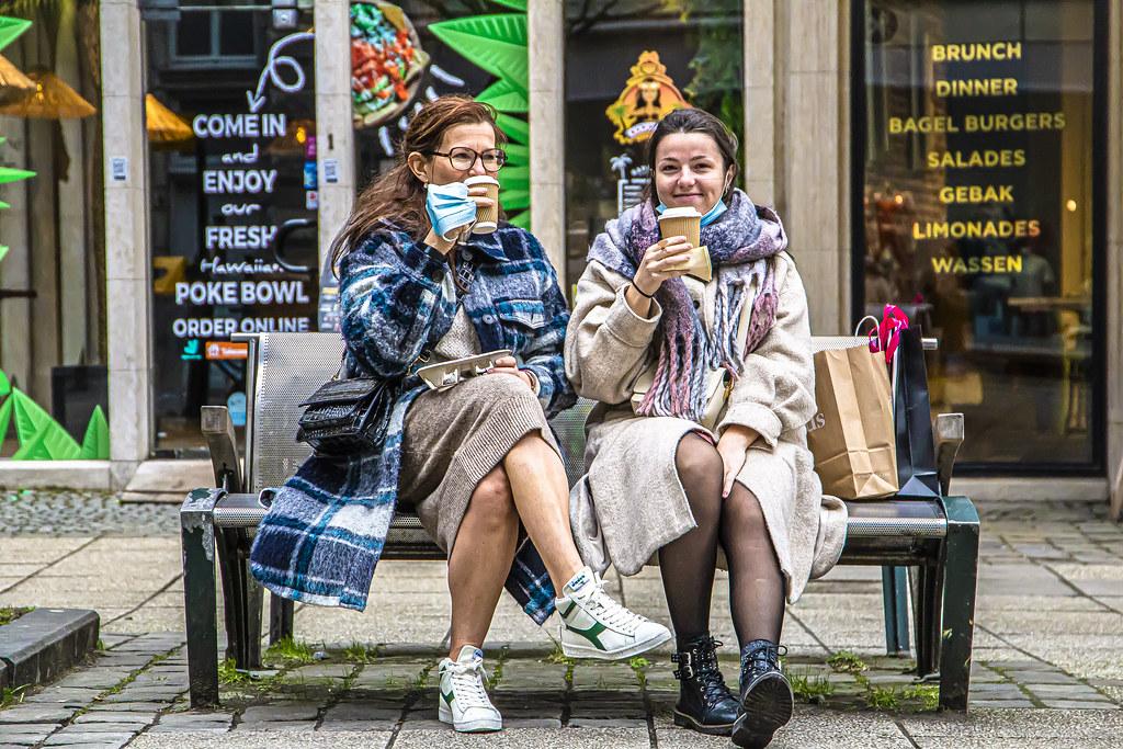 Smiling ladies enjoy their coffee