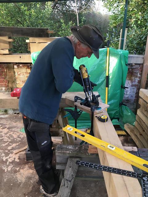 Simon using the drill guide