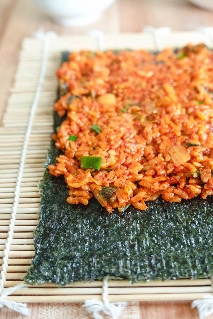 Kimchi fried rice spread overtop dried seaweed.