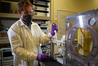 Derrick Kaseman works on the ERDE device, which uses the Earth's magnetic field to measure the unique signatures of chemicals. This portable instrument is about the size of a microwave.
