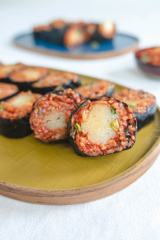 Cheese filled kimbap on a yellow tray.