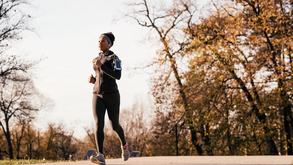 Female runner in park.