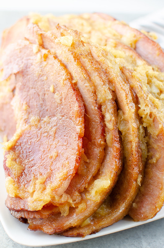 Spiral baked pineapple and brown sugar glazed ham on a white plate